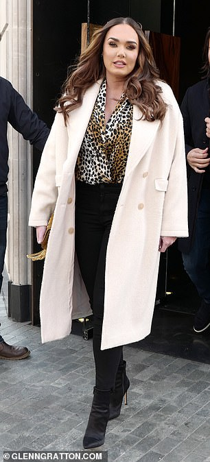 Dressed to impress: The socialite seemed in good spirits as she left Roka restaurant in Mayfair with her husband, cutting a chic figure on the outing earlier in the day
