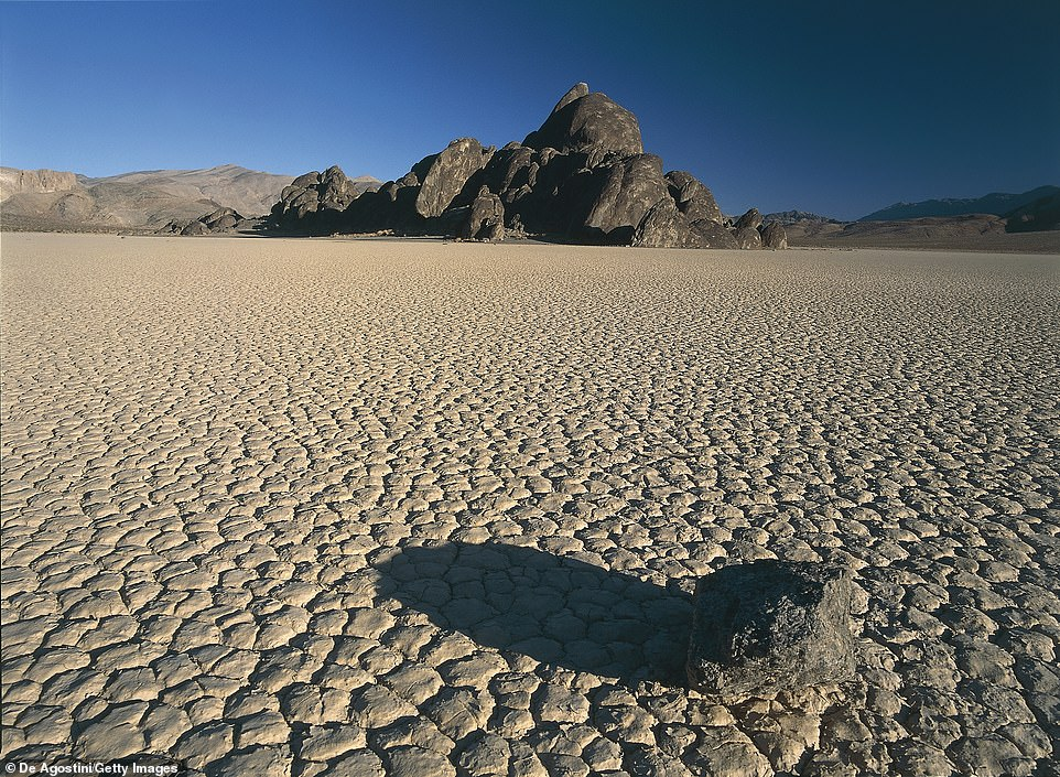 Before: The Death Valley pictured above as it usually appears throughout the year. It's so dry the ground at Racetrack Playa appears as octagonal and pentagonal shaped mud tiles