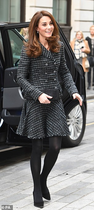 Kate cut a prim and proper figure in a black tweed skirt suit as she arrived at the event