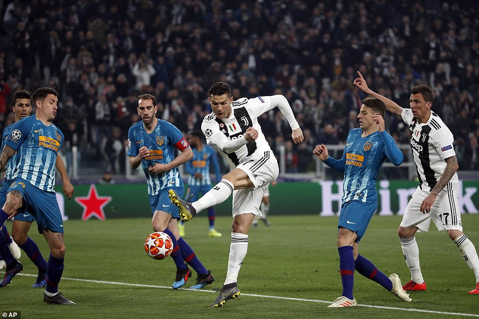 Ronaldo swivels on the ball and aims a shot at goal but cannot find the target for Juventus against Atletico
