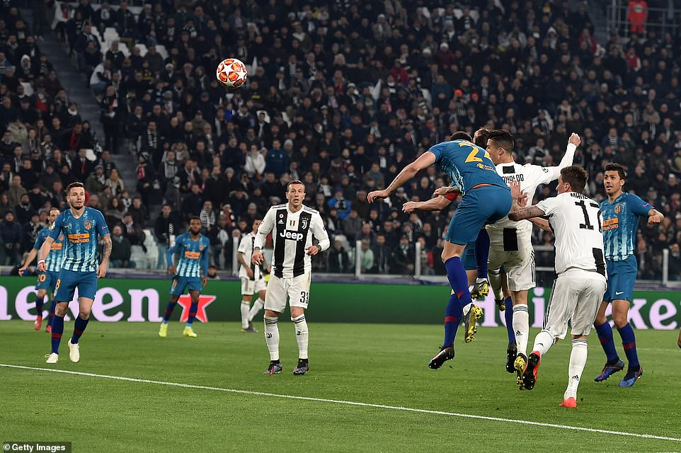 Cristiano Ronaldo heads his second goal of the night despite the best efforts of Jan Oblak to keep it from crossing the line