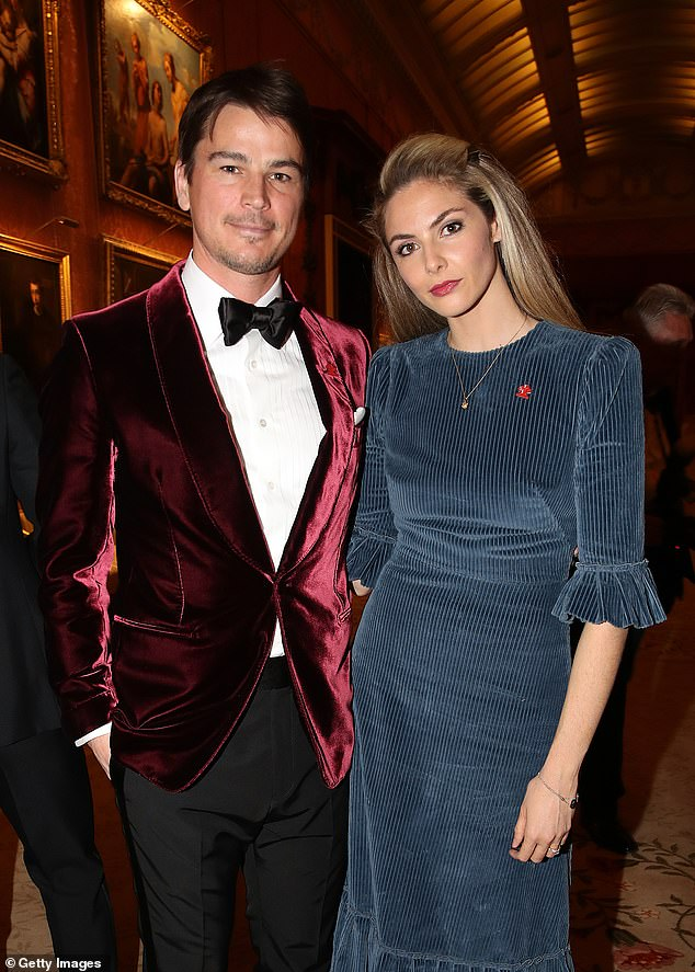 Happy family: Tamsin'spartner, 40-year-old actor Josh, opted for a bold take on a classic with a red velvet suit jacket