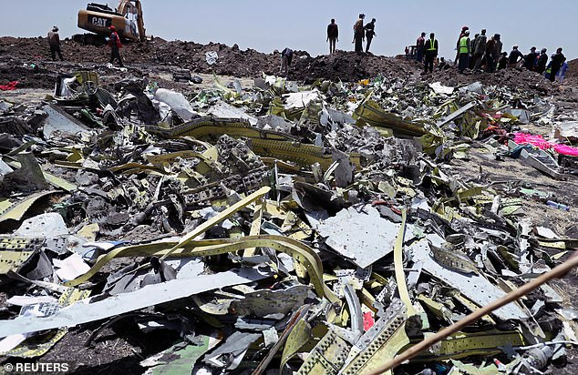 The aircraft has been suspended in countries across Europe and Asia since an Ethiopian Airlines 737 MAX fell from the sky minutes after take-off from Addis Ababa headed for Nairobi on Sunday(pictured, debris after the Nairobi-bound flight crashed)