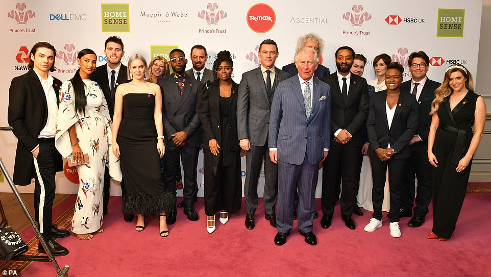 Group: The Prince looked happy as he posed with a host of celebrities at the awards