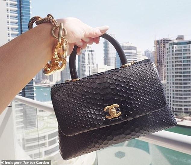 Pictured, aChanel Coco mini bag in black python, approx. cost £5,000