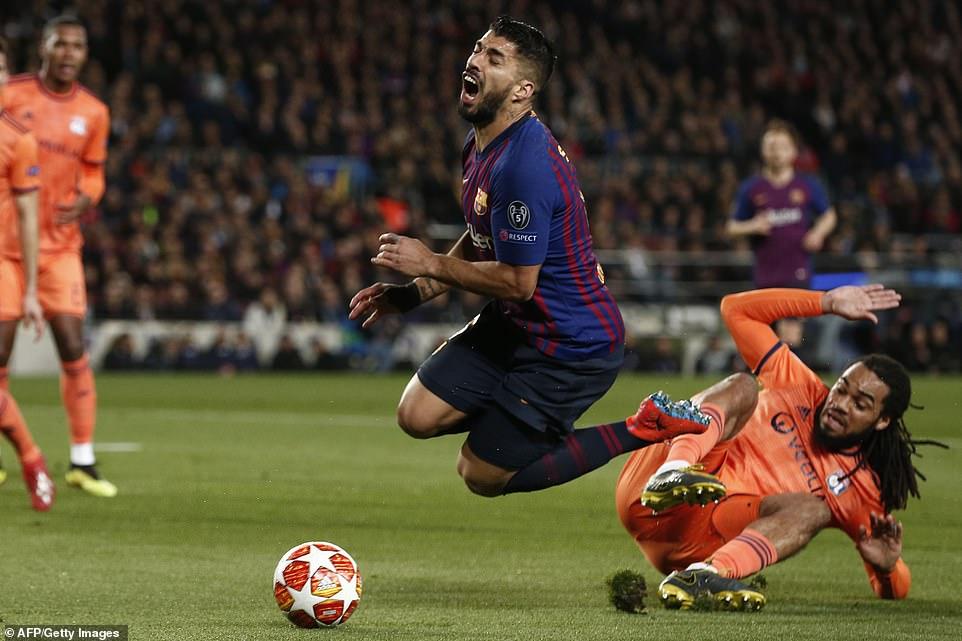 Barcelona were awarded the penalty after striker Luis Suarez was fouled byLyon's Belgian defender Jason Denayer