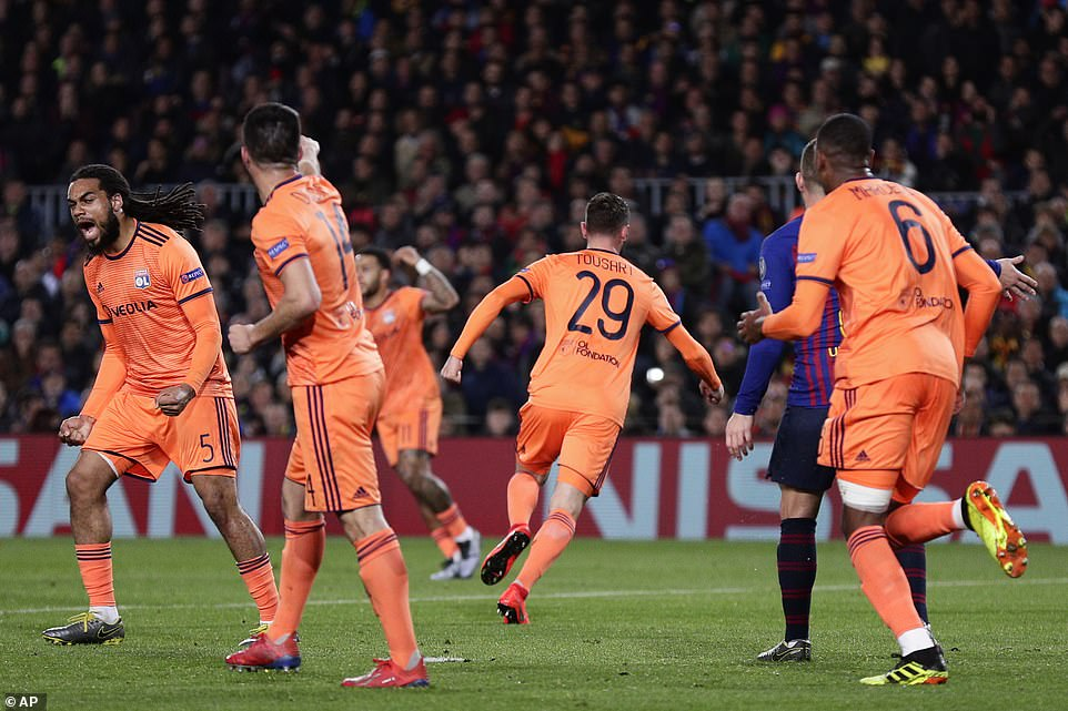 Lyon players celebrated after seeingTousart's shot hit the net but they had to wait three minutes for VAR to confirm the goal