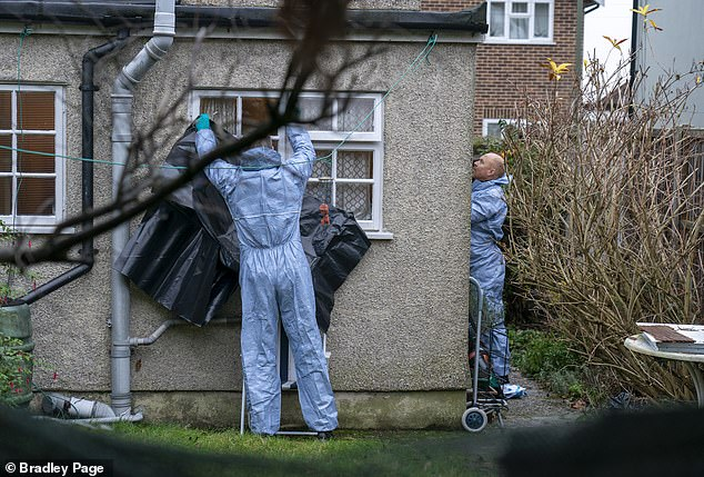 Police forensics officers (shown at the house) were seen working at the property in December