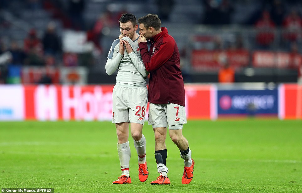 Andy Robertson is consoled by James Milner after his yellow card means he will miss the first leg of the quarter-final