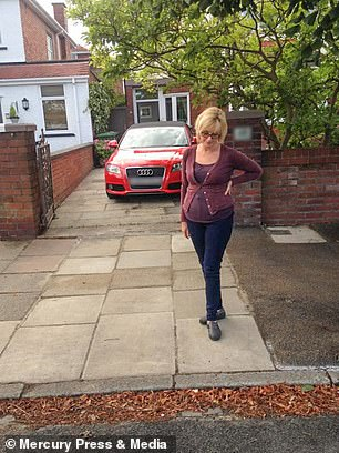 Helen had lived in the house for 12 years before she was made aware of the obscure bylaw. She is pictured here stood next to the kerb before it was lowered