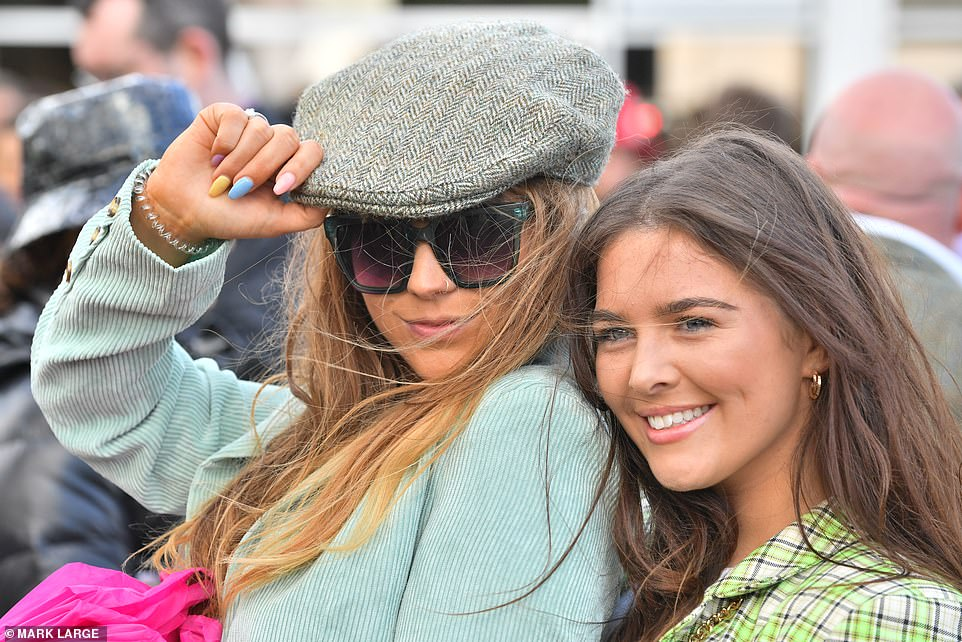 Nailing it: One stylish punter opted for multicoloured nails with a Peaky Blinders-style flat cap, while her pal was decked out in green and white tartan
