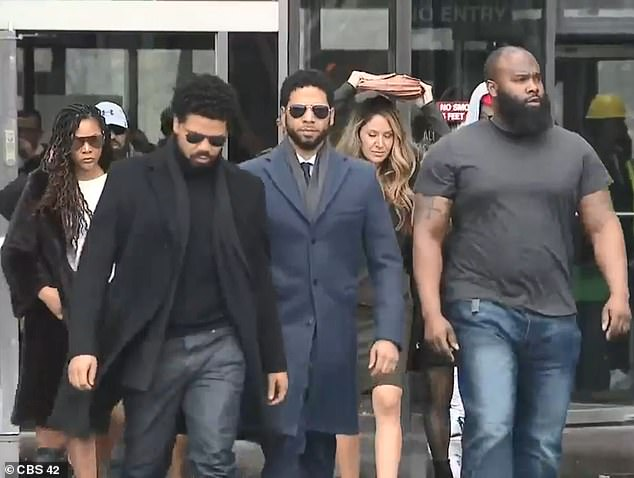 Smollett left the court with his bodyguard and family. His lawyerTina Glandian used her briefcase to protect her hair from the rain as they made the short walk to a waiting car