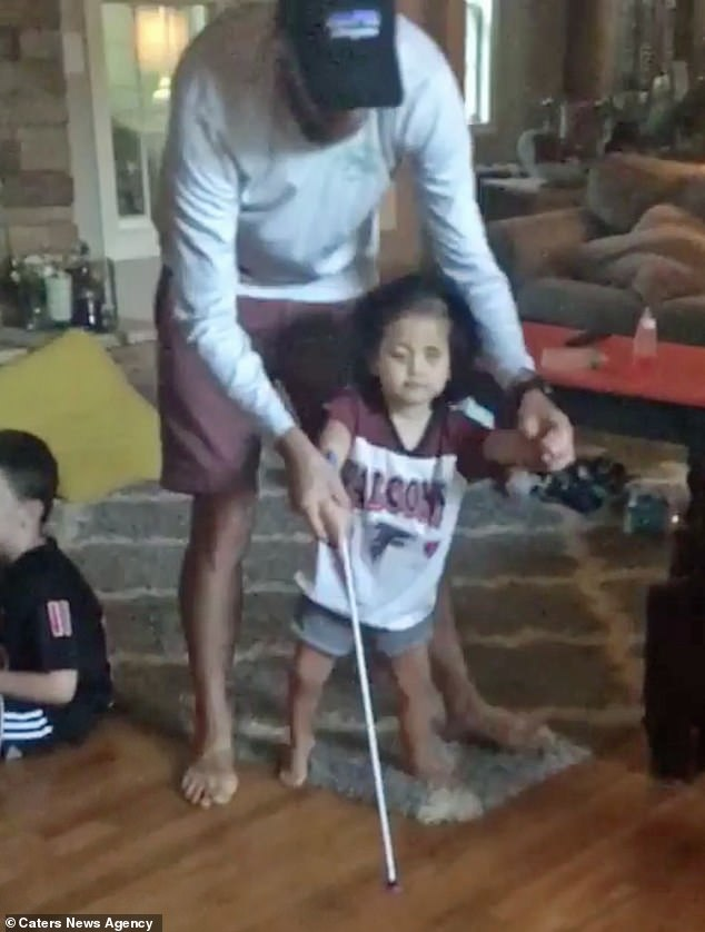 After the decision to remove her eyes, Primrose has shown dramatic improvements, and was walking again within two days. Pictured, at home learning to walk with her father