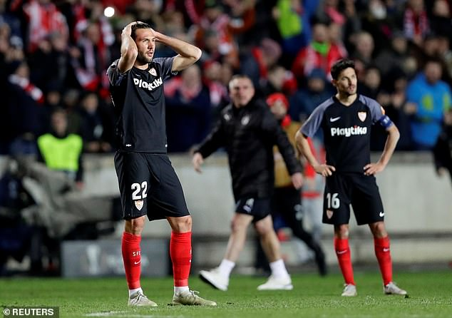 Sevilla's players look on in shock at their first defeat in the competition since 2011