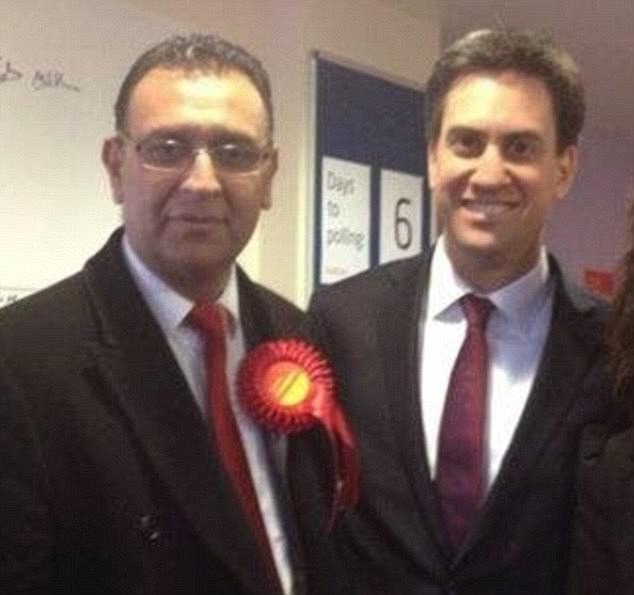 Jahangir Akhtar, pictured with ex-Labour leader Ed Miliband, lost his seat on the council at elections in 2014 when he was defeated by a UKIP candidate