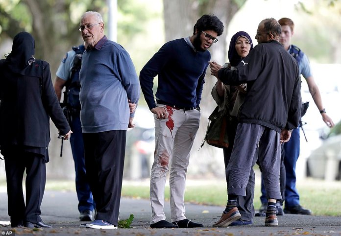 A man was seen with bloodstains on his trousers near the mosque after the shooting