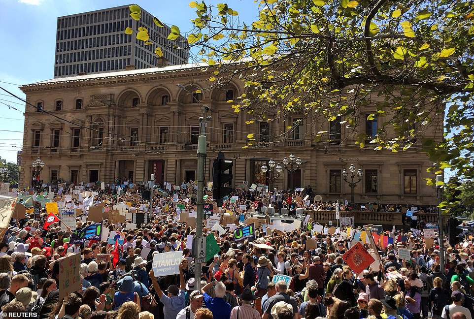 Protesters demanding action on climate change gather in Melbourne on Friday as rallies are held across the nation
