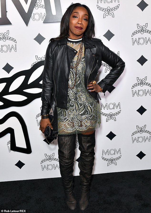 Flowery dress: American Boy singer Estelle showed off a classic black leather jacket over a lacy shirt and added a pair of black thigh-high boots