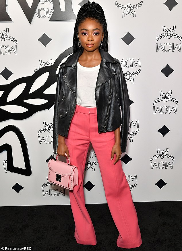 Color burst: Disney Channel star Skai Jackson had a black leather jacket draped over her shoulders, mixed with a white T-shirt and hot pink slacks