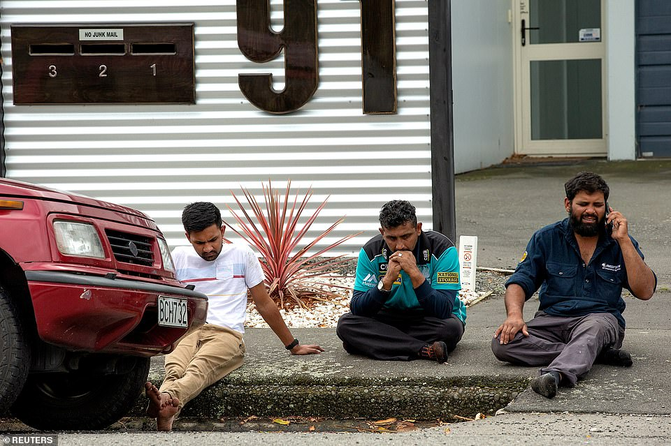 Pictured: Grieving members of the public after the shootings at mosques in Christchurch, New Zealand