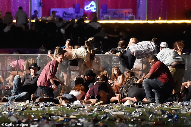 Terrified country music fans scramble to cover as Paddock rained down terror from his Mandalay Bay room in Las Vegas
