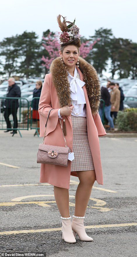 This reveller opted for a vintage pink ensemble topped off with a stunning floral and feathered hat