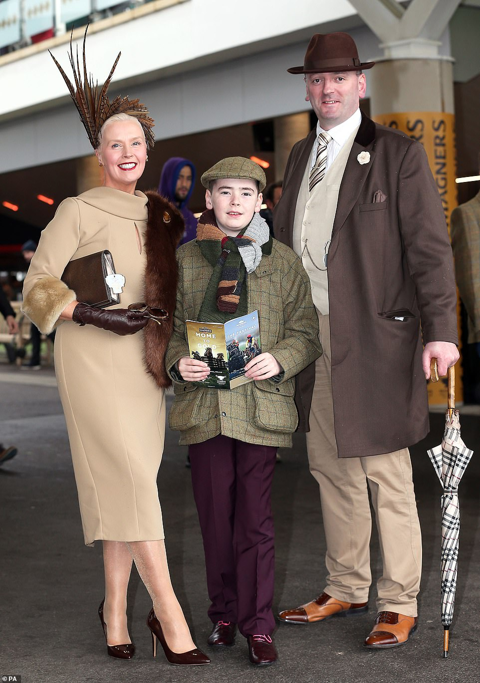 Family affair:Gillian (left), Patrick and Raymond Gilborne returned to Cheltenham today, and their chic outfits were yet again impressively coordinated