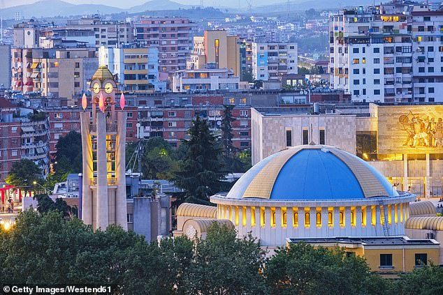 Unorthodox promotion: Albania's latest campaign to encourage tourism links to a film about gangsters which it says is just stereotyping because the countryis 'a beautiful and incredibly safe place to visit and live' with Tirana's orthodox cathedral (above) among the draws