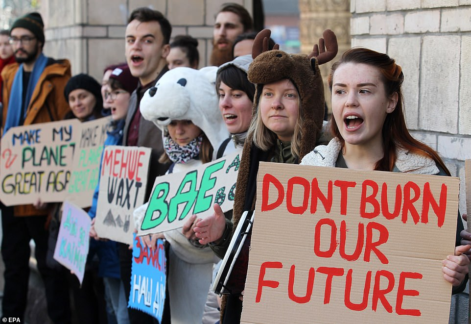 And in Kiev, Ukraine, students shout slogans during the 'Global Climate Strike for future' protest, in front the Ministry of Energy and Coal Industry