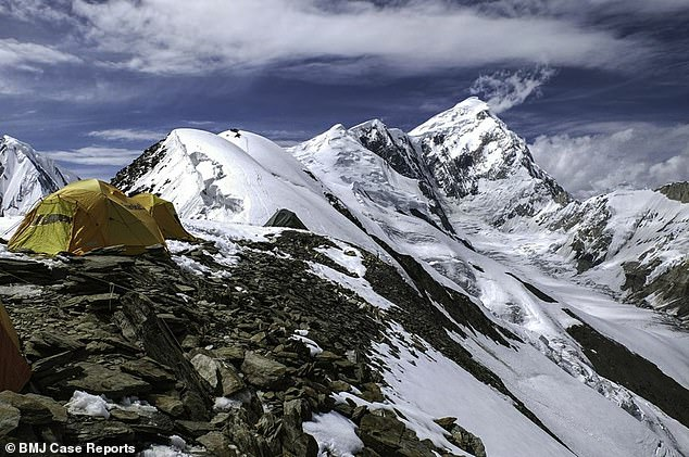 The man climbed the Spantik mountain (pictured) in Pakistan. He made it to 6,900m altitude, just 131m from the summit, before he had to turn back because of exhaustion and hypothermia