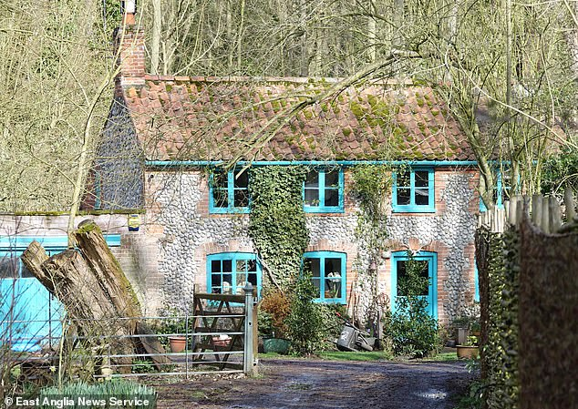Alastair Taunton, defending, insisted that Tremain had not put up the sculpture at his three bedroom home Flint Cottage (pictured) with the intent of causing offence.Tremain said after the hearing that he was unable to comment due to his restraining order, but he described his v-sign sculpture as 'quite hilarious'