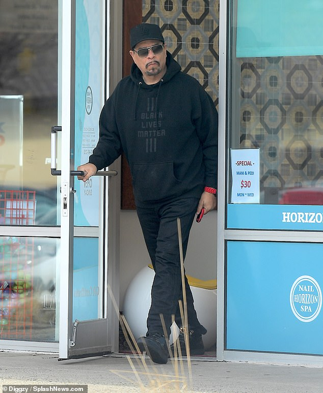 Dashing: While out with his wife Thursday, Ice-T could be seen wearing a Black Lives Matter hoodie and a pair of black trousers with glinting matching sneakers