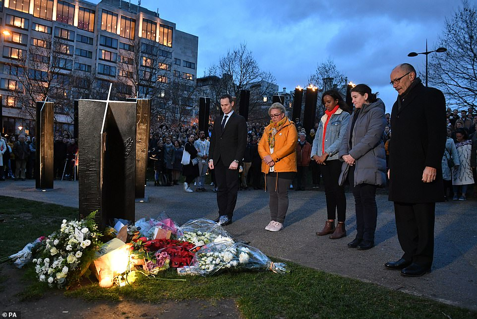 People taking part in a vigil at the New Zealand War Memorial on Hyde Park Corner following the mosque attacks in Christchurch