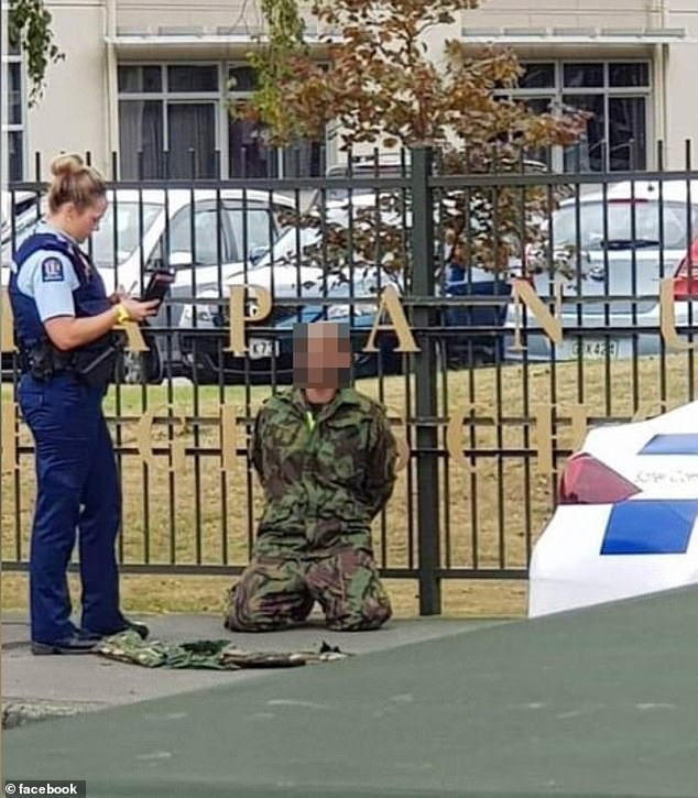 A man wearing military fatigues (pictured) was arrested outside Papanui High School in Christchurch after the shooting