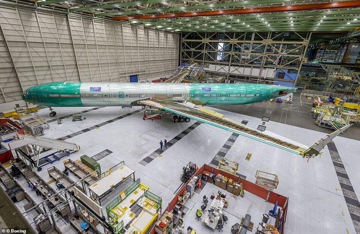 Last year, Boeingreleased a video and pictures of a 'static' 777X, pictured, rolling off the production line at the Everett factory. It was built for testing and is not destined for the skies