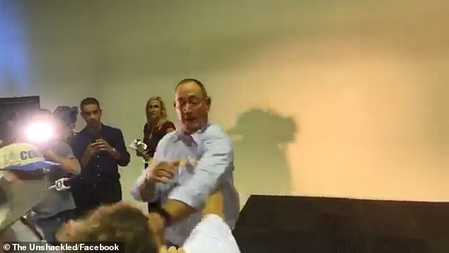 The man then slams an egg on to the back of the Senator's head who spins his body and takes a swipe at the youngster