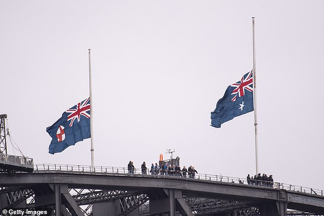 Flags fly at half mast on the Sydney Harbour Bridge
