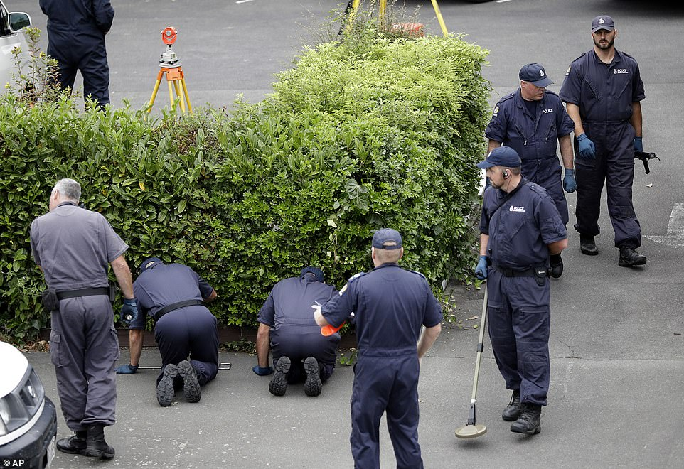 The investigation is ongoing as police are seen scouring the shrubbery of a motel near the Al Noor Mosque in Christchurch