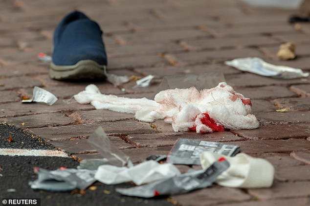 Bloodied bandages on the road following a shooting at the Al Noor mosque in Christchurch yesterday