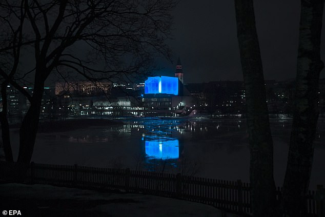 Finland's congress hall shone a vivid blue to commemorate the victims, while the New Zealand flag still flies at half-mast in the country's capital of Wellington