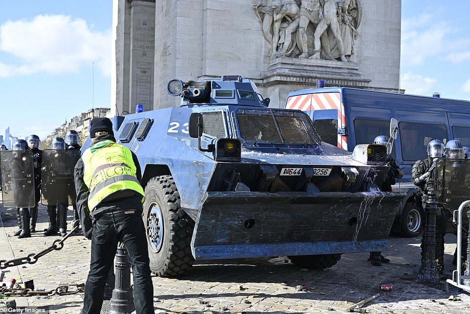 Security forces bring in armoured vehicles to guard the Champs Elysees as tensions continue to grow over the increased taxes and high cost of living