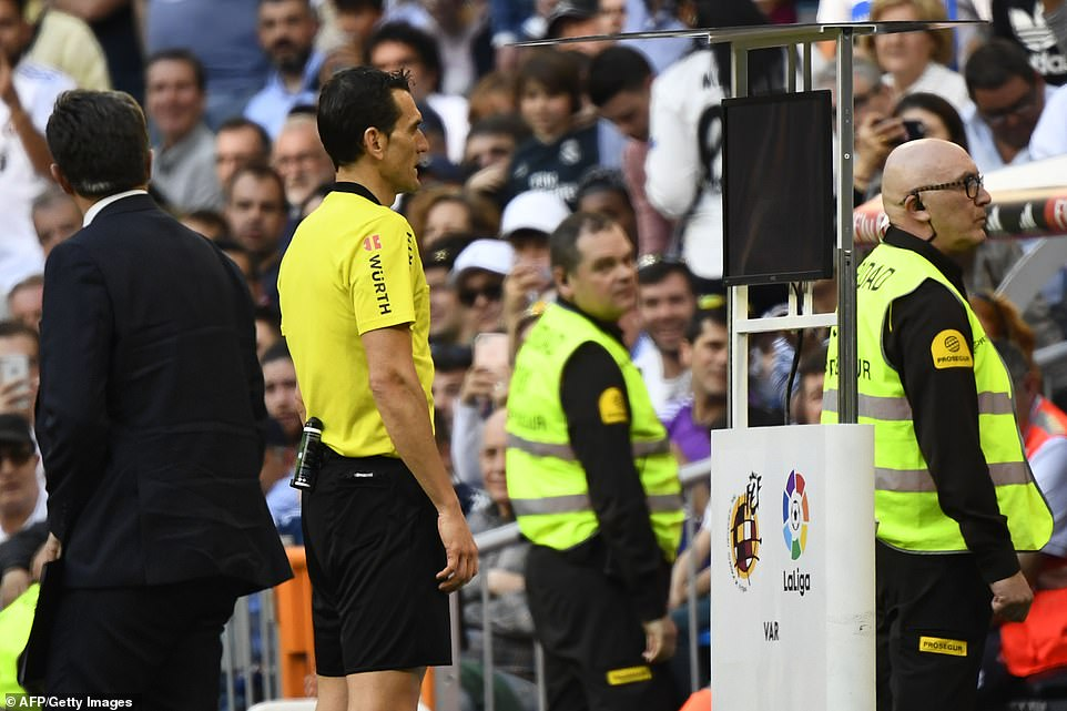 Spanish referee Juan Martinez Munuera checks the VAR (Video Assistant Referee) to eventually rule out Luka Modric's goal