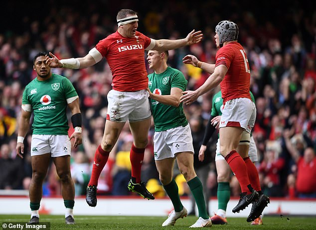 Hadleigh Parkes celebrates his second-minute try after handing Wales the perfect start to their Grand Slam decider against Ireland in Cardiff