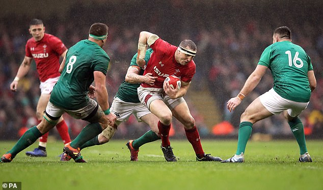 Parkes tries to break through the Irish lines at the Principality Stadium on Saturday afternoon