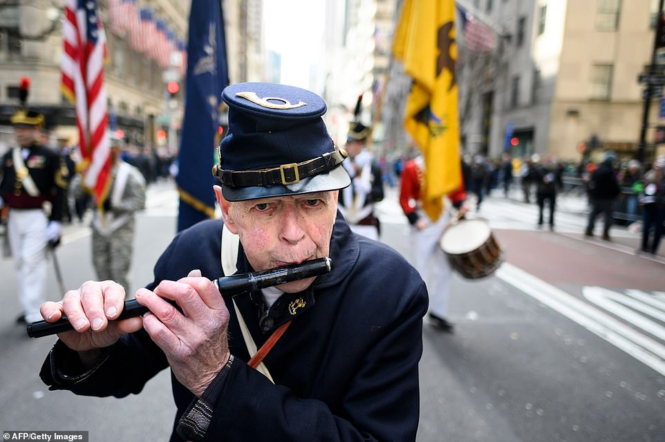A piper marches on 5th Avenue during the annual New York City St. Patrick's Day Parade in Manhattan's Midtown area