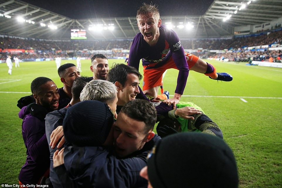 Oleksandr Zinchenko and his Manchester City team-mates are jubilant following the final whistle