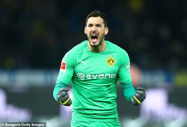 DortmundRoman Burki clenched his fists in celebration after his side's late winner in Berlin