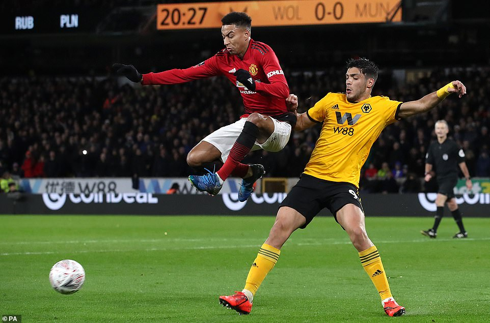 Manchester United's Jesse Lingard (left) and Wolves' Jimenez battle for the ball during the FA Cup quarter-final