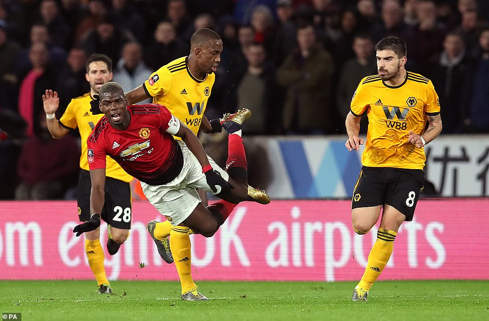 Manchester United midfielder Pogba is fouled by Wolves defender Willy Boly during the first period of the FA Cup tie