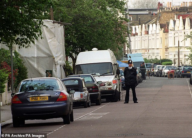 Miss Dando, was shot once in the head. Neighbours found her slumped against her front door in a pool of blood. Pictured are police at the scene soon after the shooting